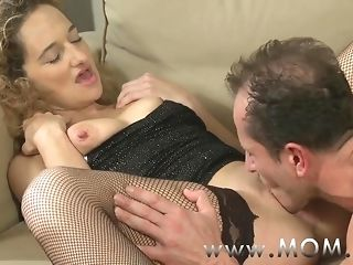 Mommy nasty curly haired cougar procurement pummeled on the couch porn video